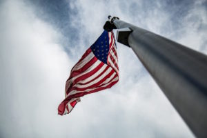 Flagpole with American flag by Christopher Burns from stocksnap.io