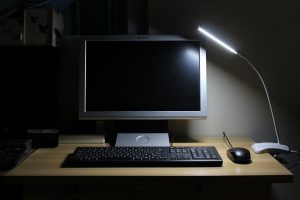 Computer with dim desk lamp