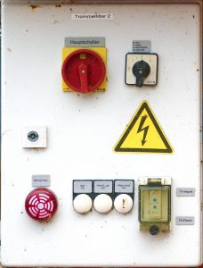Industrial-looking switches and symbols on a wall