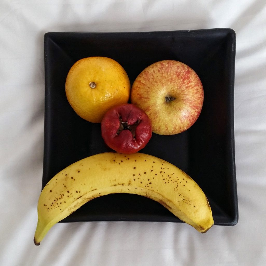 Fruit plate depicting an unhappy face