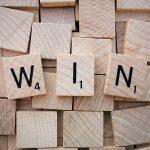"""Scrabble tiles spelling """"win"""""""