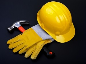 Yellow hard Hat, red hammer and work gloves