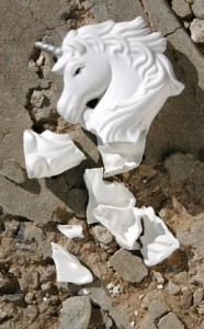 Shattered porcelain unicorn on broken background
