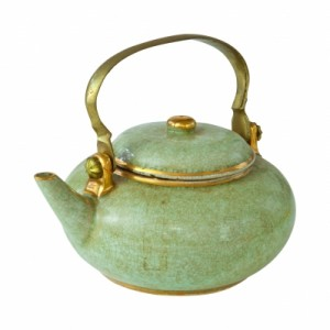 Old green teapot with gold handle and trim