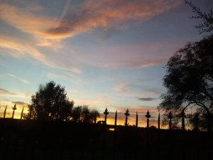 Fence silhouetted against the sunset in Winchester, VA, by Judy K. Walker