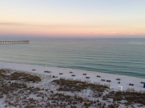 Sunset on beach behind Margaritaville Hotel, Pensacola Beach, FL, by Judy K. Walker