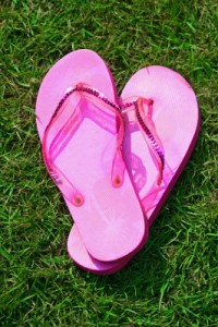 "Pink ""Flip Flops"" on the grass by James Barker on freedigitalphotos.net"