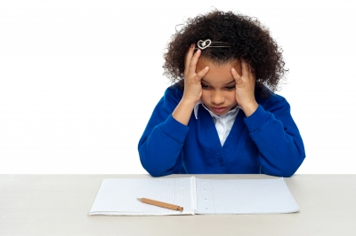 """""""Stressed Out Primary Girl Child Holding Her Head"""" by stockimages on freedigitalphotos.net"""