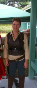 Judy K. Walker wearing homemade Firefly vest and holster at Halloween