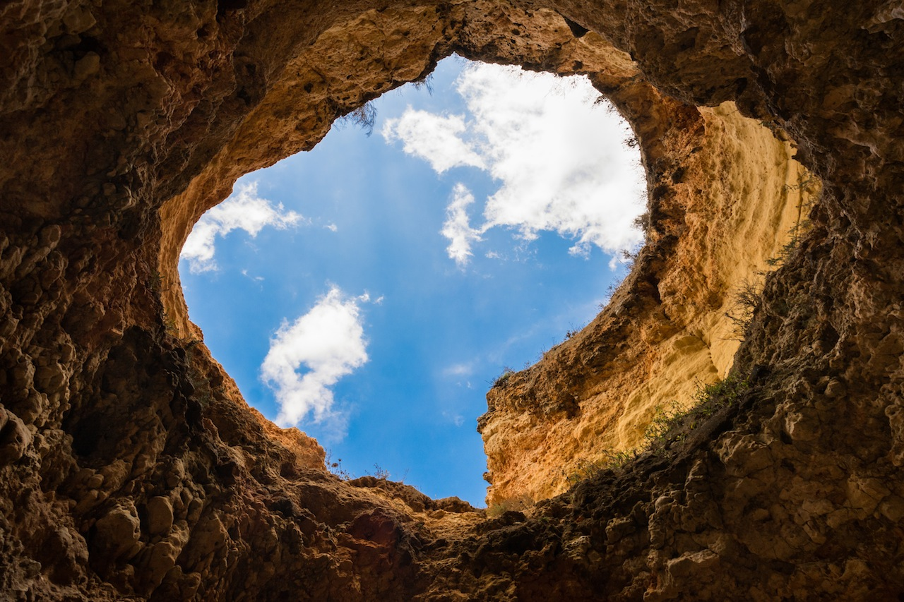 Hole in cave to sky by Skitter Photo from stocksnap.io