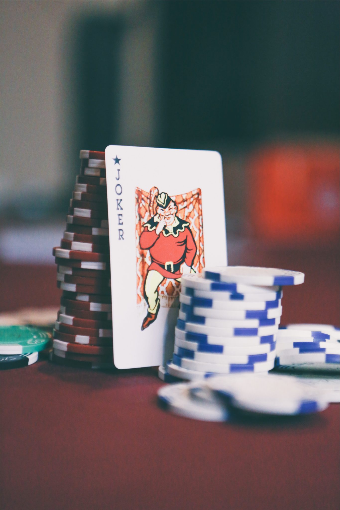 Joker card with stack of chips by Matthew Smith from stocksnap.io