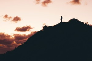 Man's silhouette on mountain by Jordan Hile from stocksnap.io