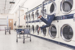 Woman falling in dryer at laundromat by Ryan McGuire from stocksnap.io