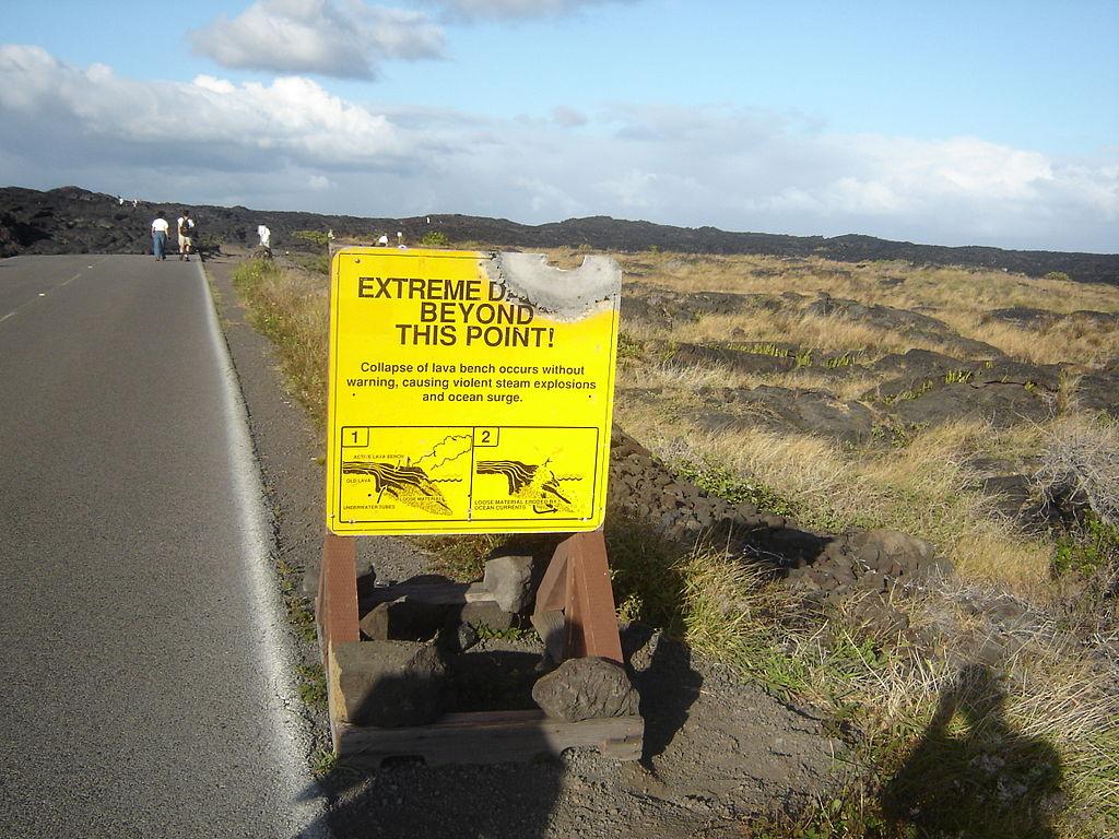 Lava-damaged Hawaiian Sign by Kip Robinson, public domain