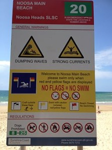 Noosa Heads SLSC sign at Noosa Main Beach by Kgbo, public domain