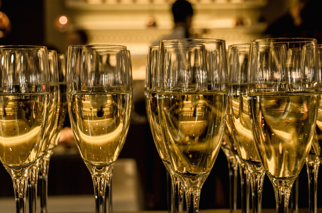Rows of champagne glasses by Skitter Photo from stocksnap.io