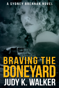 "Ebook cover for ""Braving the Boneyard,"" the fifth book in Judy K. Walker's Sydney Brennan Mysteries"