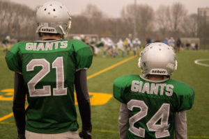 Kids on football field by Skitter Photo from stocksnap.io