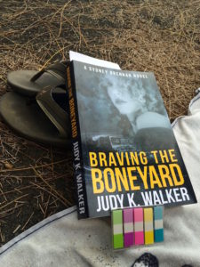 "Paperback proof for ""Braving the Boneyard"" on an East Hawaiian beach"