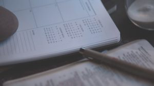 Person writing in Planner by Brandon Redfern from stocksnap.io