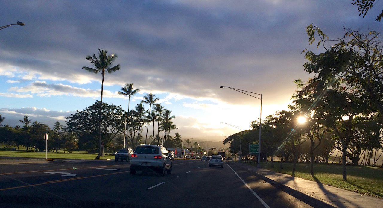 Driving down Kalanianaole Ave toward downtown Hilo by Judy K. Walker