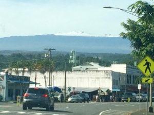 View of snowy Mauna Kea from downtown Hilo by Judy K. Walker