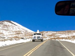 Pickup truck with snowman on the back by Judy K. Walker