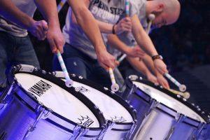 Three college men drumming