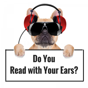 Dog wearing headphones asking, Do you read with your ears?