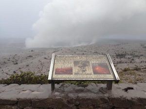 Ash-covered sign at Jaggar Museum viewing area on May 17, 2018